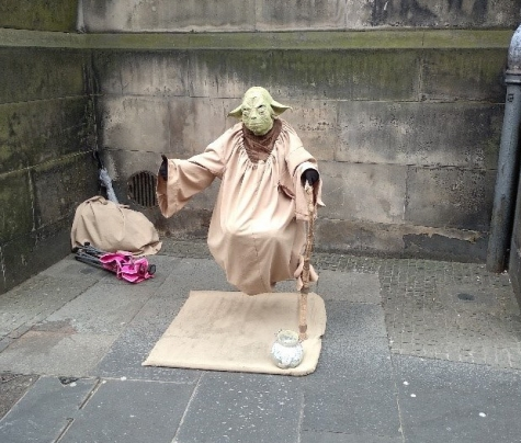 Yoda getting money from tourists next to St Giles