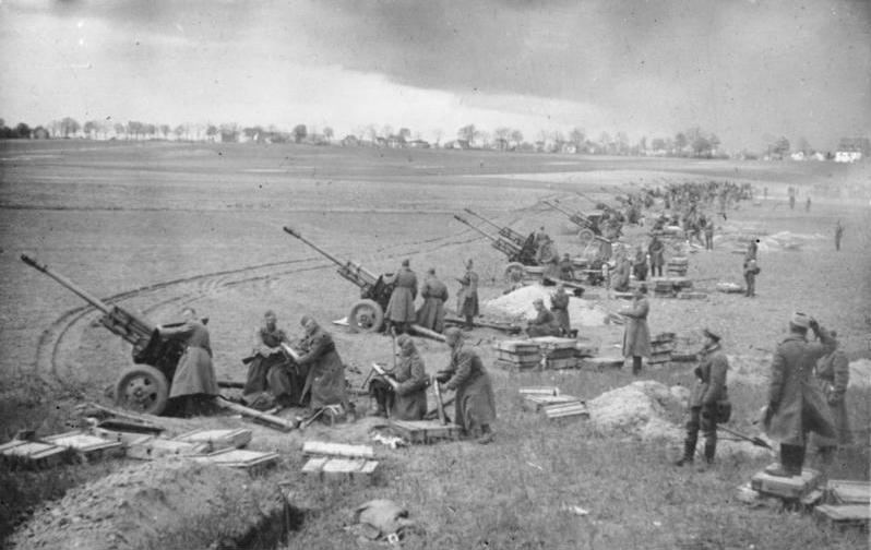 A long line of Soviet guns open fire