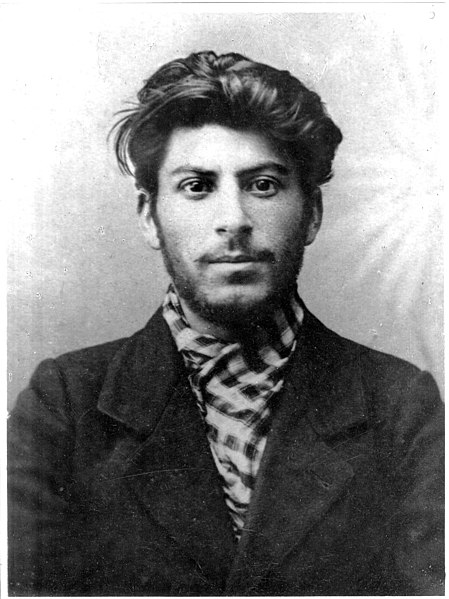 Stalin in his mid 20's. His clothes are dingy, but he would do well in a shampoo ad.
