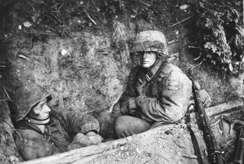 One of th soldiers has a sad look, while the other is more inexpressive. His rifle on his side