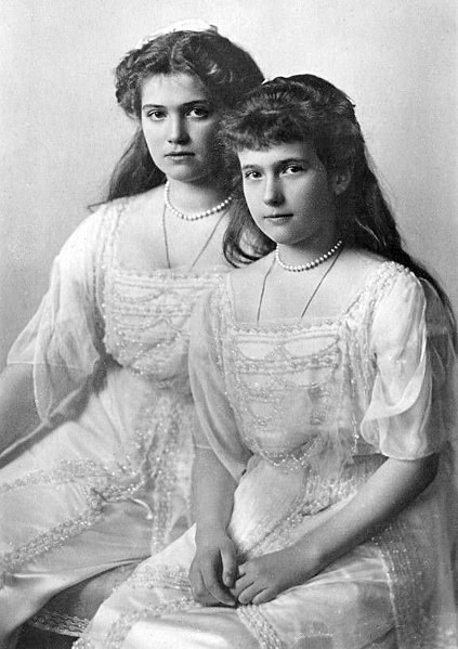 Maria and her younger sister Anastasia, both have the same dres and pearl necklace