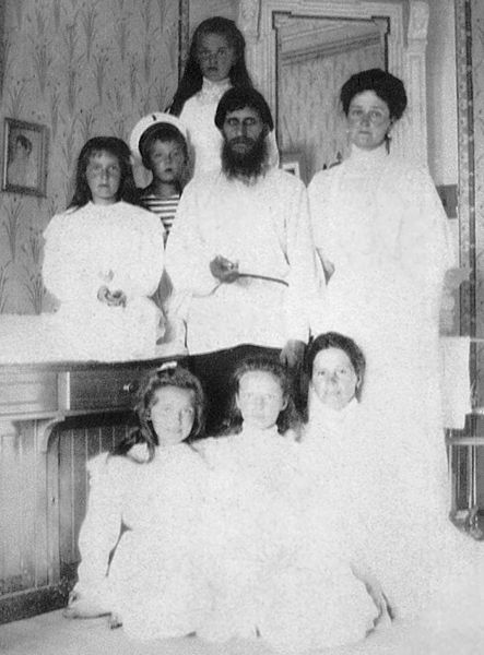 Alexandra, her daughters, the governess, and Rasputin, all dressed in white. The little Alexis is dressed as a sailor