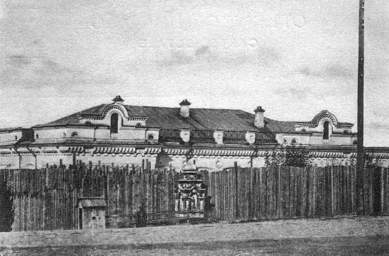 The infamous Ipatiev House surrounded by a palisade