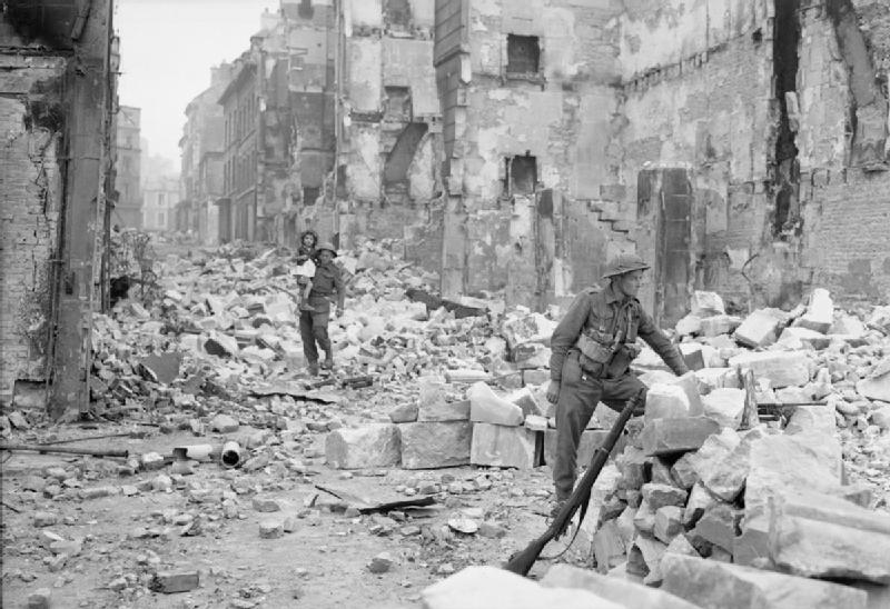 One of the soldiers seems to explore a heap of ruble and masonry while the other Briton stands behind carrying the girl on his arms