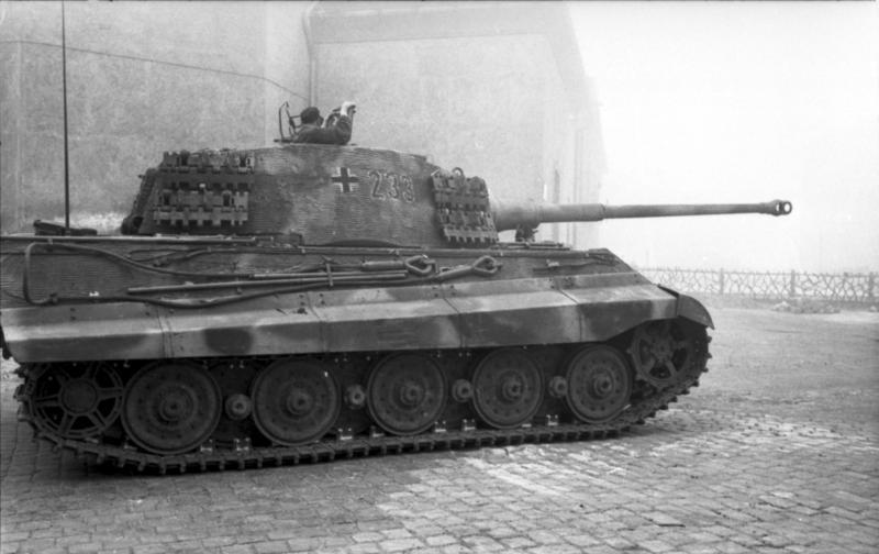 Tiger II or Königstiger with a 88mm gun. The heaviest tank of WW2. It saw action for the first time in Normandy. Less than 500 units were produced