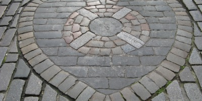 A mosaic of cobbles shaped like a heart