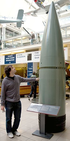 A man is dwarfed by the projectile, surpassing 3 metres at least