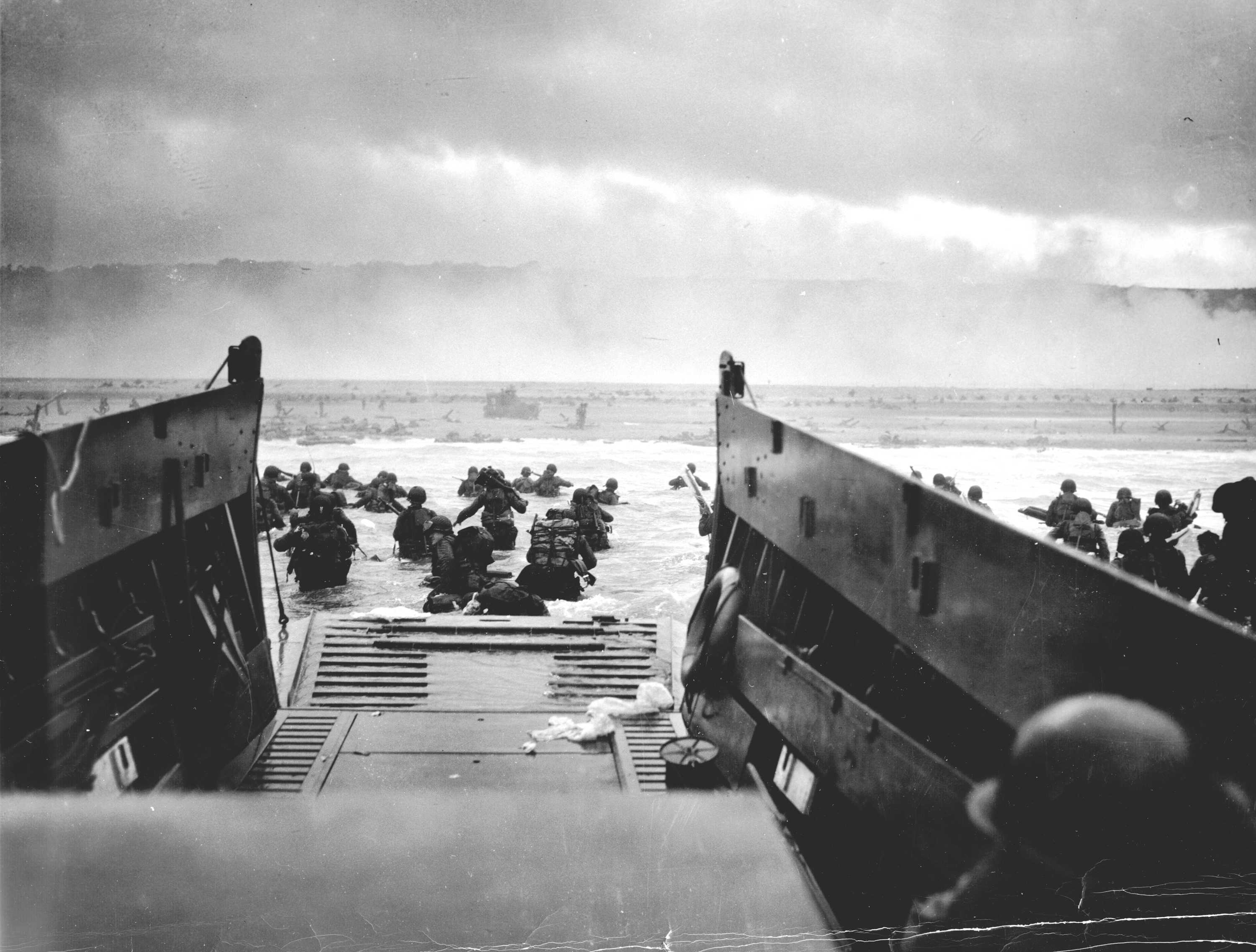 Taken from within the landing craft. The men of the Big Red One are water waist and a never-ending misty beach stretches in front of them