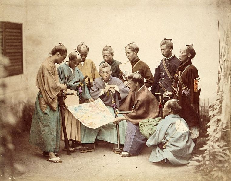 Some samurai are wearing traditional attires whereas others wear western uniforms. All have katanas and are checking a map
