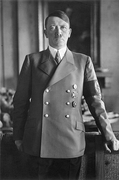 An official picture of Hitler with a stern look in the Reich's Chancellery