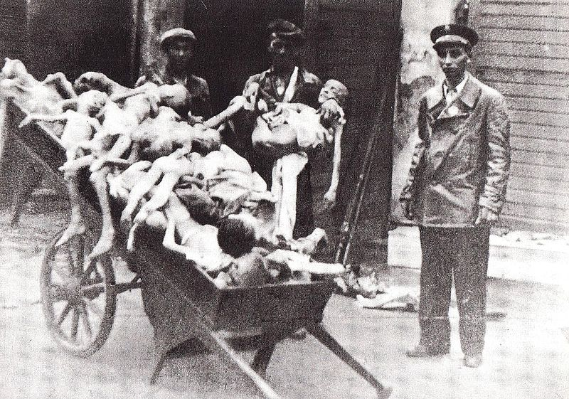 A cart of piled-up corpses of children